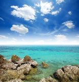 Clear water and Stone beach. Sea Clear water and Stone beach blue sky paradise in Thailand stock image
