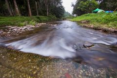 Clear water stream near campground of National Park Guard unit,Pa La-U Waterfall,Kaeng Krachan National Park,Hua Hin,Prachuap Khir. Pa La-U Waterfall is located Stock Image