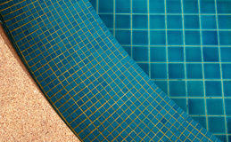 Clear water in the swimming pool. Blue bright royalty free stock image