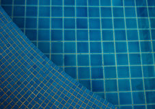 Clear water in the swimming pool blue bright. Background royalty free stock images