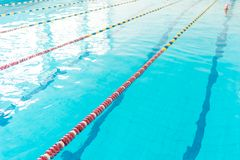 Clear water of swimming pool. Reflections on water surface royalty free stock photography