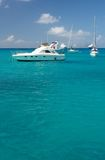 Clear water, tropical island, yachts and boats Royalty Free Stock Photos