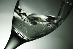 Clear Water in Wine Glass Stock Photo