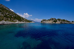 The clear waters of The Mediterranean from a bay in Greece Royalty Free Stock Images