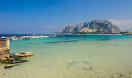 Clear waters of Mondello. Boats anchored in clear turquoise waters of Mondello with Palermo on background, Sicily, Italy Royalty Free Stock Images