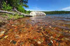 Clear Waters of Northwoods Wisconsin. Beautifully colored rocks shine through clear waters in a northwoods Wisconsin Lake Stock Images