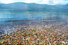 Clear waters of Yellowstone Lake show pebbles. Stock Photos