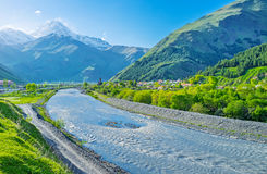 The clear weather in Kazbegi. The sunny weather in Sno valley offers the view on the Kazbek Mount, rising above the villages, Kazbegi, Georgia Stock Photos