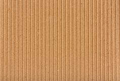 Clear yellow corrugated cardboard texture. Stock Photos