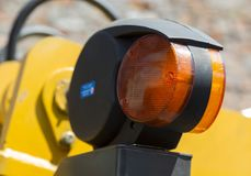 Warning orange clearance light of road machinery close-up stock images
