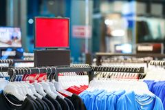 Clearance red label woman sports ware in sports store environment royalty free stock photography