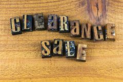Clearance sale retail business sign letterpress. Clearance sale letterpress type wood letters small business wooden sign message typography royalty free stock photography