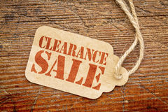Clearance sale sign on a paper price tag Royalty Free Stock Photo