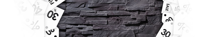 Clearance sale on texture of gray stone wall stock image