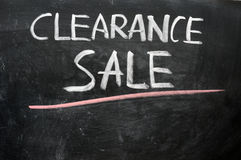 Clearance sale written on a blackboard Stock Images
