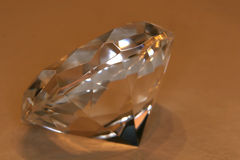 Clearcut diamond. A clear diamond standing by itself Stock Photos