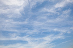 Cleared blue sky with tiny white clouds. Stock Images