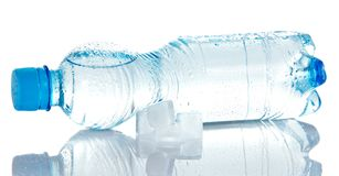 Cleared drinking water in bottle, and ice cubes Stock Photos