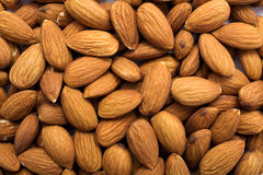 Cleared golden almonds background. The ripe, cleared golden almonds background royalty free stock photography