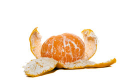 The cleared orange. Orange with which the peel (lies on the peel) is partially removed Stock Photography