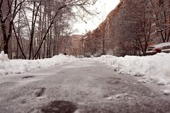 Cleared path in the yard of the house in a residential area. Heavy snowfall in the city.  stock photo