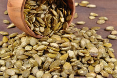 Cleared pumpkin seeds in a bowl Stock Image