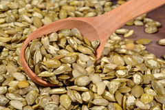 Cleared pumpkin seeds in a spoon Royalty Free Stock Images