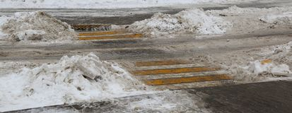 Cleared of snow unregulated pedestrian crossing. A cleared of snow unregulated pedestrian crossing stock images