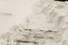 Cleared snowy footpath after heavy snowstorm. Winter background royalty free stock images