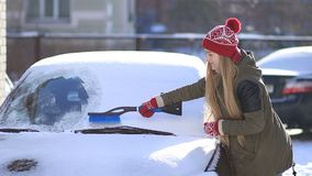 Clearing automobile`s windscreen from snow stock footage
