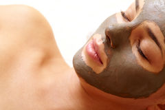 Clearing face. Relaxed girl having pore cleaning mask in isolation royalty free stock images