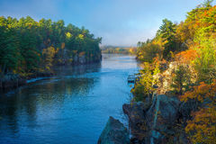 Clearing fog, st.croix river. Clearing morning fog on the st. croix river in interstate state park, minnesota, autumn Royalty Free Stock Images