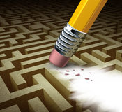 Clearing The Path. Business solutions as a metaphor for removing a complicated maze by a pencil eraser as a concept of innovative thinking for financial success Stock Image