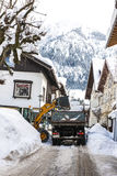 Clearing a road from snow in Oberstdorf, Germany Royalty Free Stock Photography