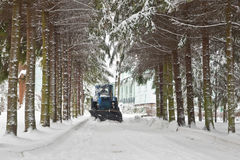 Clearing roads of snow. Bulldozer clears snow from the road Royalty Free Stock Image