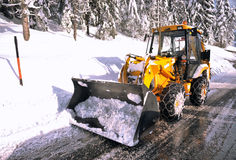 Clearing roads of snow Stock Images