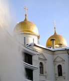 Clearing roofs from snow. Assumption church. Royalty Free Stock Image