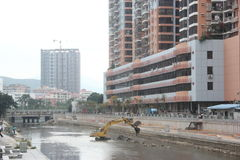 Clearing sludge Excavators in The Shenzhen River Stock Image