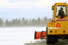 Clearing the Snow. Snow plow removing snow at airport after a winter storm Stock Photography