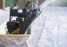 Clearing snow. With snow blower Stock Photo