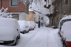 Clearing Snow from Car Roof Royalty Free Stock Image
