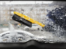 Clearing snow from car window Royalty Free Stock Photo