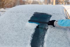 Clearing snow off a car Royalty Free Stock Photo