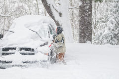Clearing snow off vehicle Stock Image