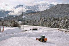 Clearing snow from the parking lot for cars Stock Photo