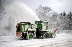 Clearing of the snow on road. Royalty Free Stock Images
