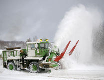 Clearing of the snow on road. Stock Photos