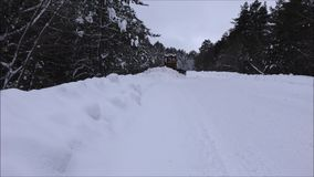 Clearing snow from the road. Crawler Tractor grader clears snow from the road stock footage