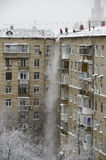 Clearing snow from the roof Moscow. 2014 December Royalty Free Stock Photo