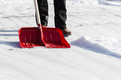 Clearing snow shovel Stock Photos